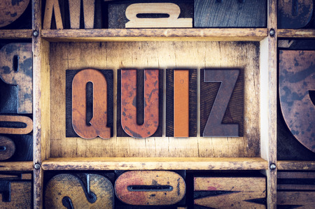 "50435335 - the word ""quiz"" written in vintage wooden letterpress type."
